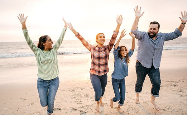 Family smiling Cucalon Orthodontics in San Francisco CA